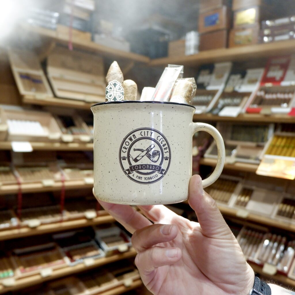 cup of cigars branded with Crown City Cigars logo in the humidor